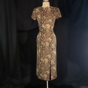 Scarlett snakeskin print dress with gold treads.
